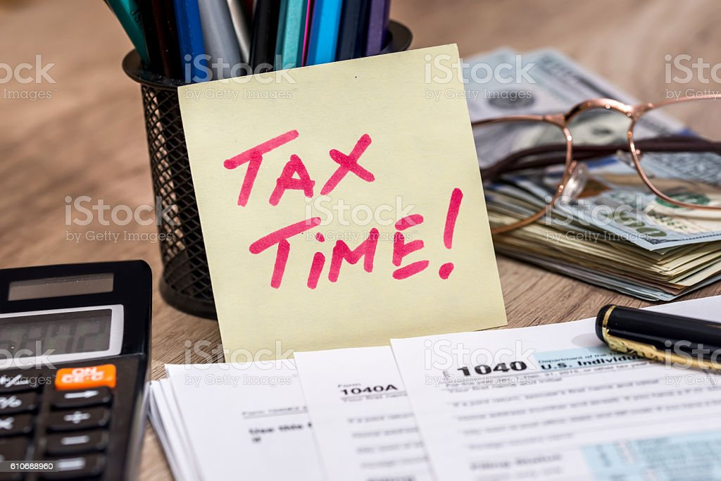 tax form with calculator, money and pen stock photo