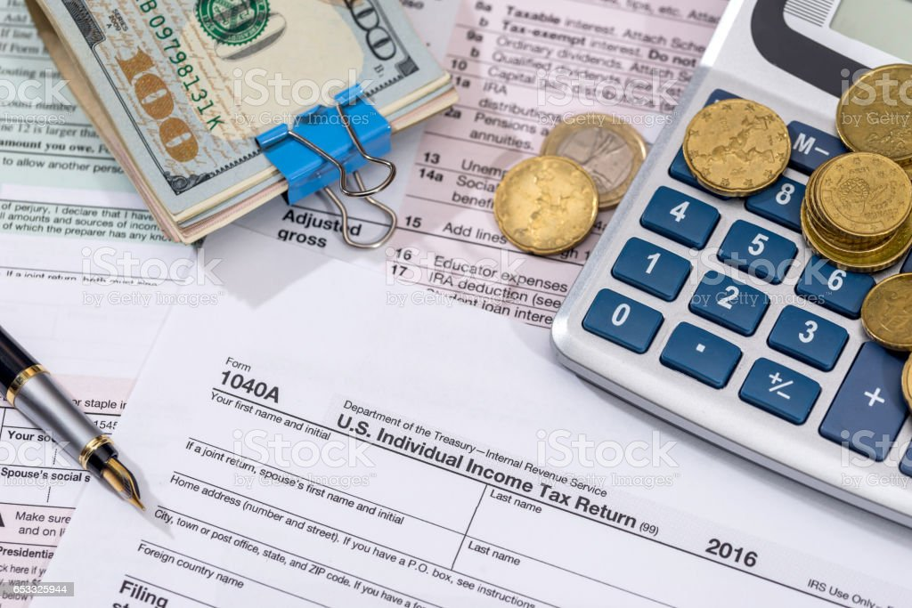 1040 tax form with money, pen for 2017 year. stock photo