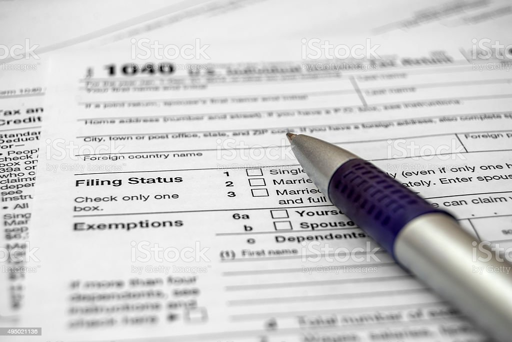 Tax form with pen stock photo
