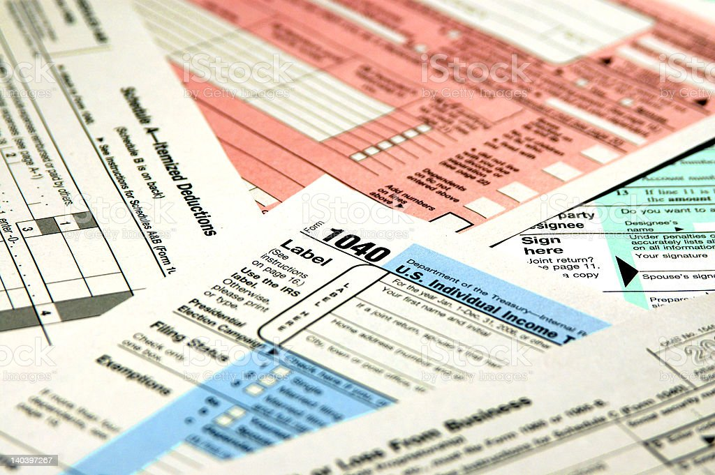 Tax forms and schedules royalty-free stock photo