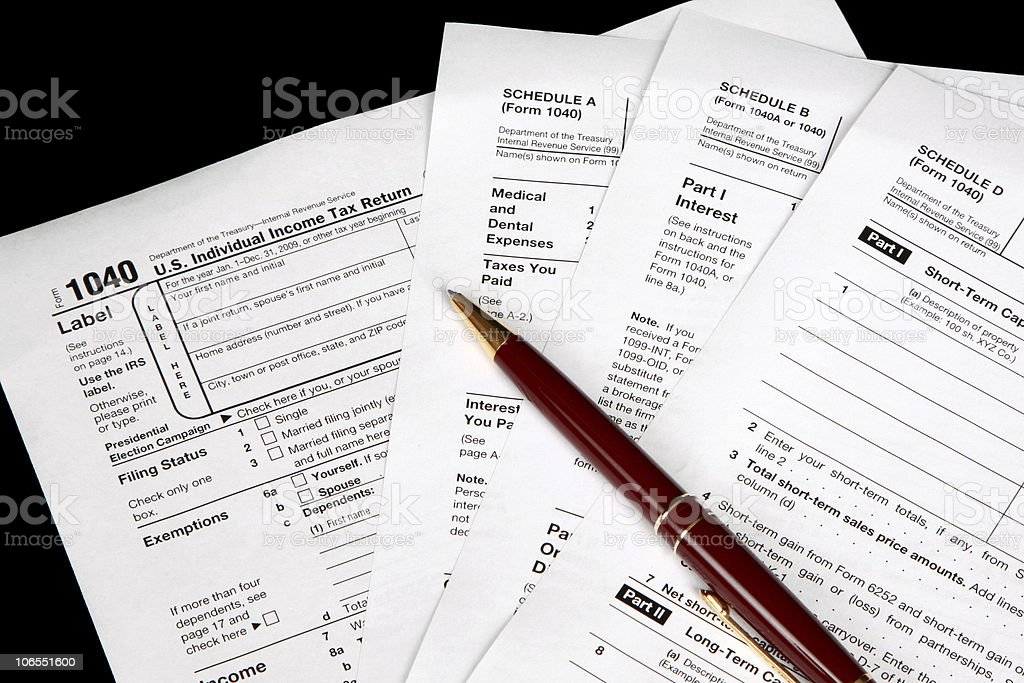 Tax forms on a black background stock photo