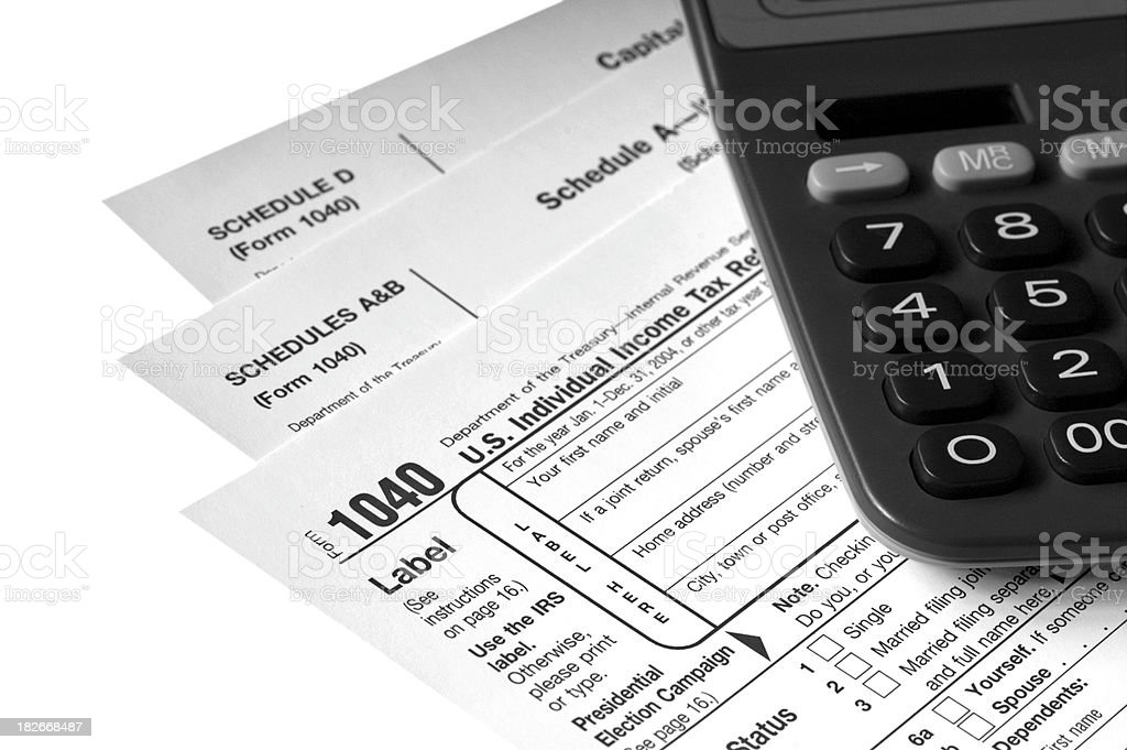 Tax Forms with Calculator stock photo