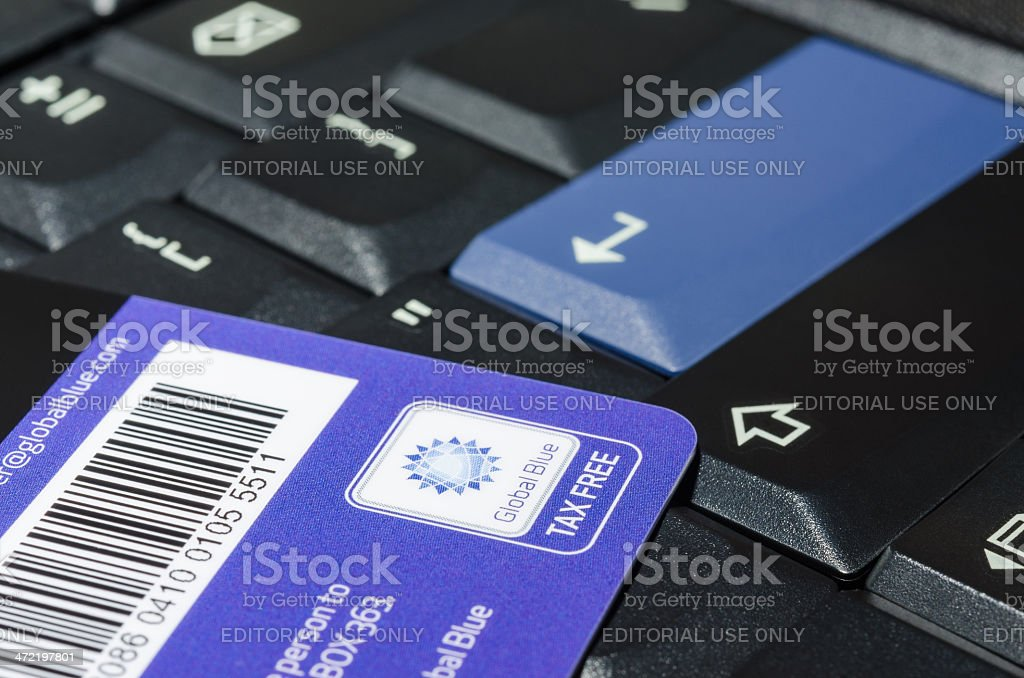 Tax free company Global Blue card on black notebook keyboard stock photo