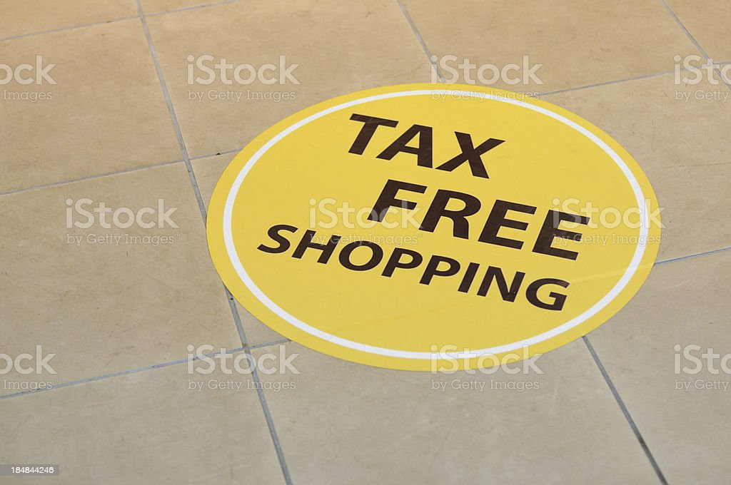 Tax Free Shopping sign on floor royalty-free stock photo