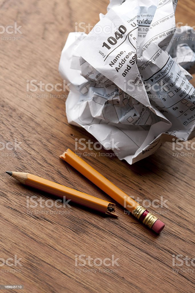 Tax Frustration - 1040 Form and Broken Pencil royalty-free stock photo
