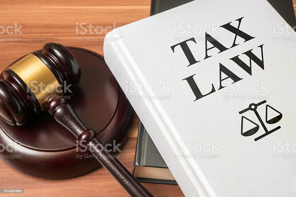 Tax law book and gavel. Consumer protection book and gavel. stock photo