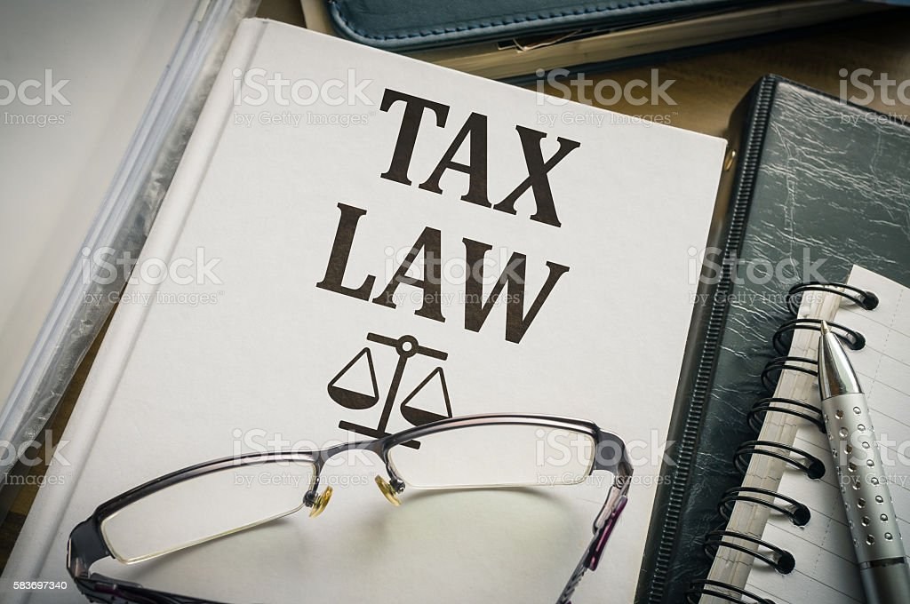 Tax law book. Legislation and justice concept. stock photo