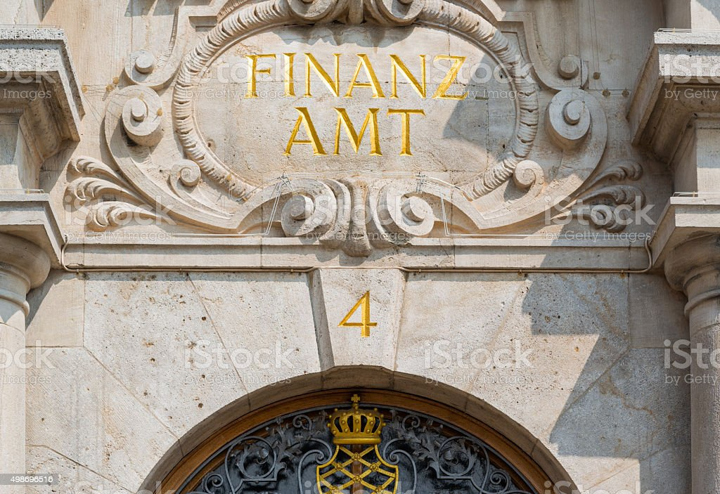 Finanzamt in golden letters stock photo