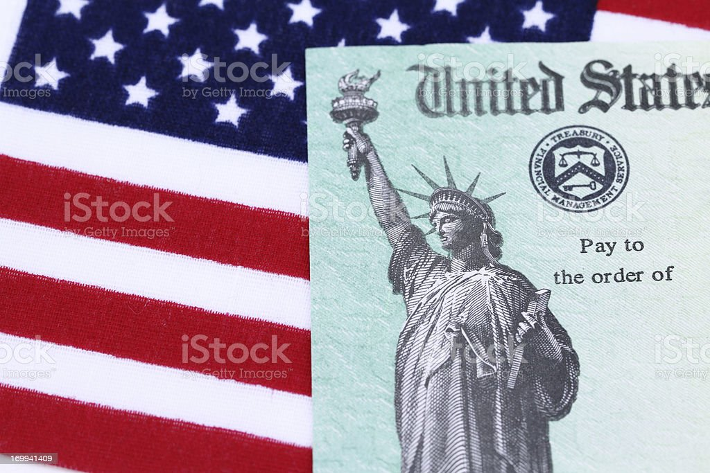 IRS tax refund check on American flag royalty-free stock photo