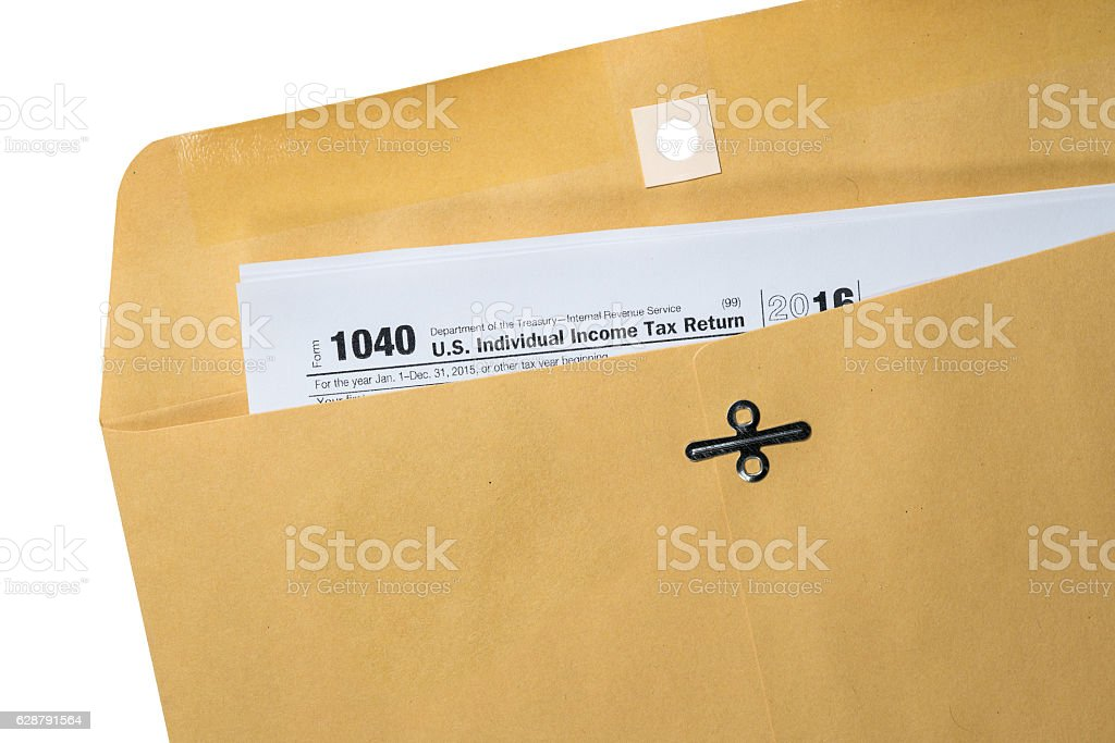 Tax return printed and placed in envelope stock photo