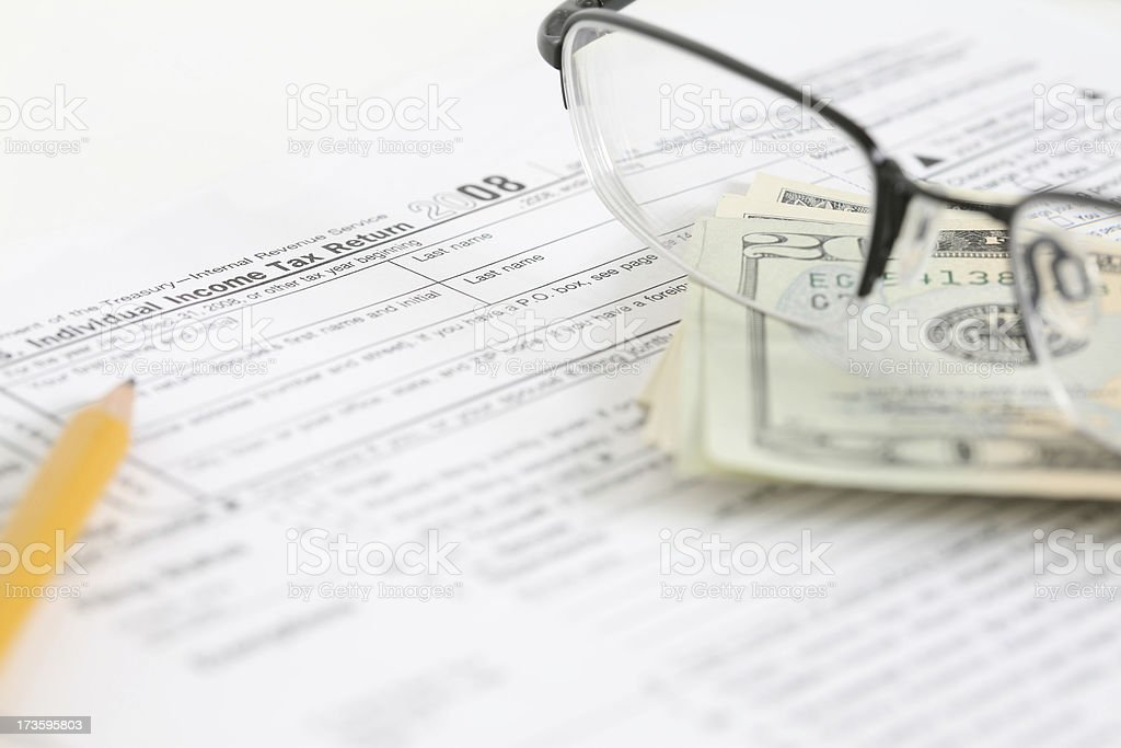 Tax Return with Money, Glasses, and Pencil royalty-free stock photo