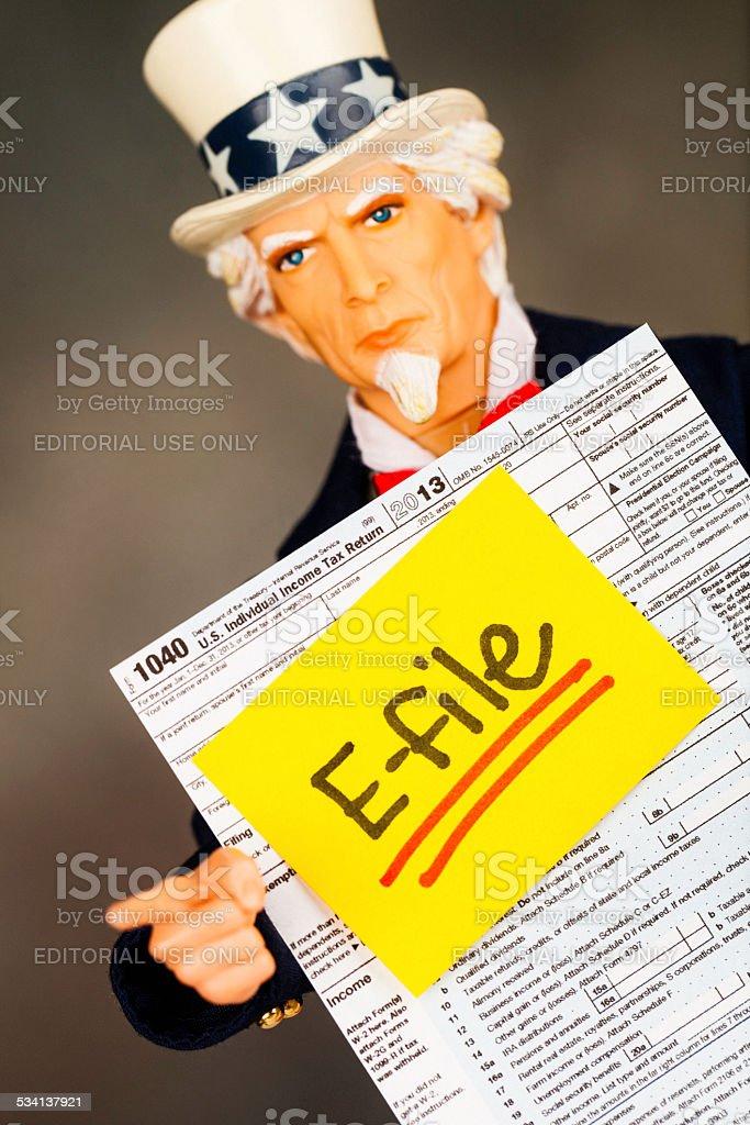Tax Season: E-File. Uncle Sam with Tax Form stock photo