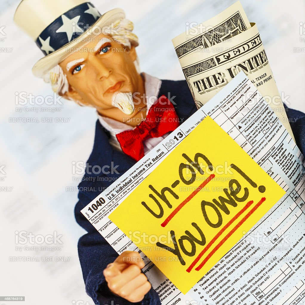 Tax Season: Uncle Sam with Warning that You Owe Taxes! royalty-free stock photo