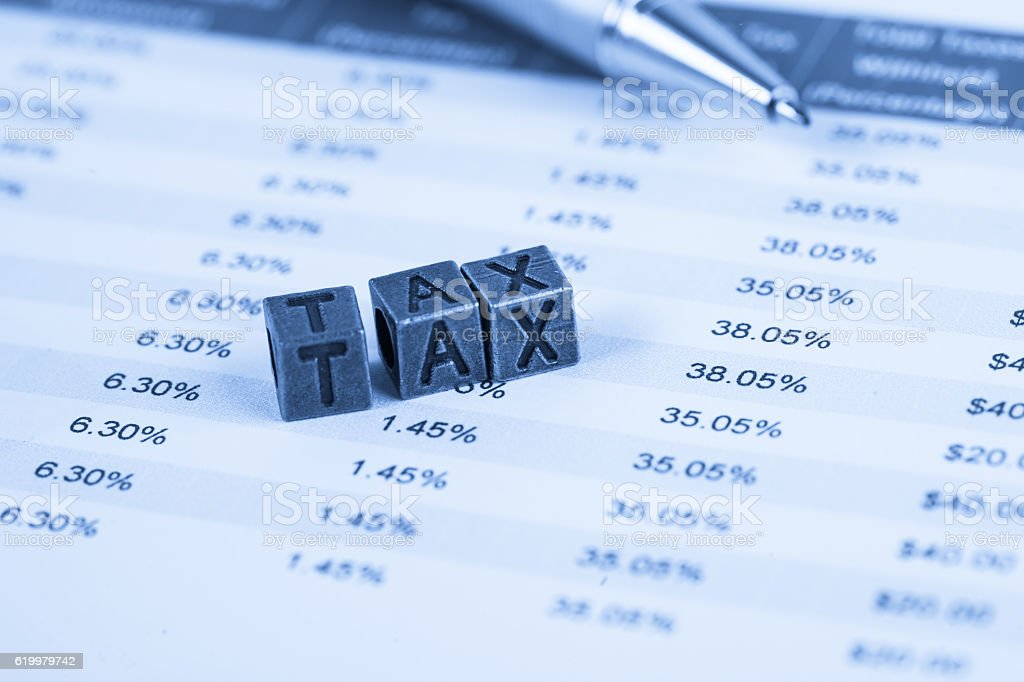 tax spreadsheet with copper tax cubic stock photo