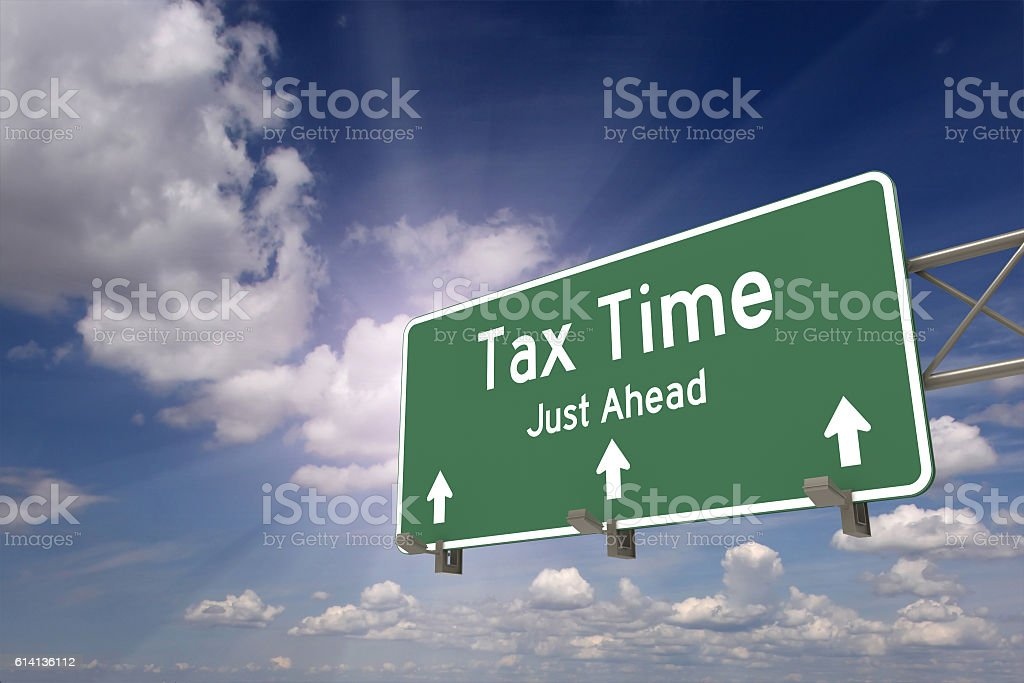Tax time ahead road sign concept stock photo