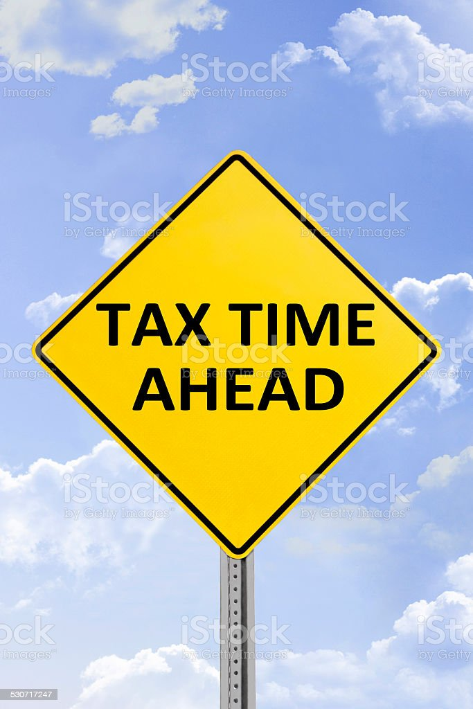 Tax Time Ahead Yellow Road Sign stock photo