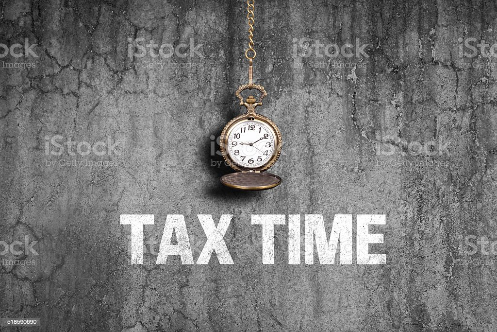 Tax time on old wall stock photo