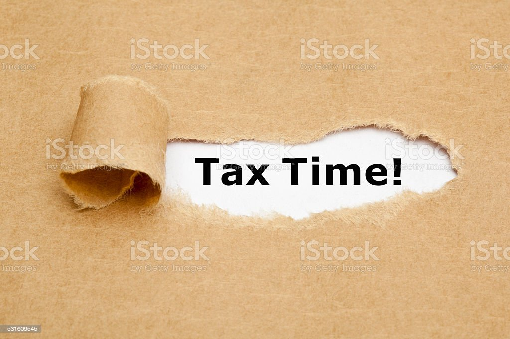 Tax Time Torn Paper stock photo