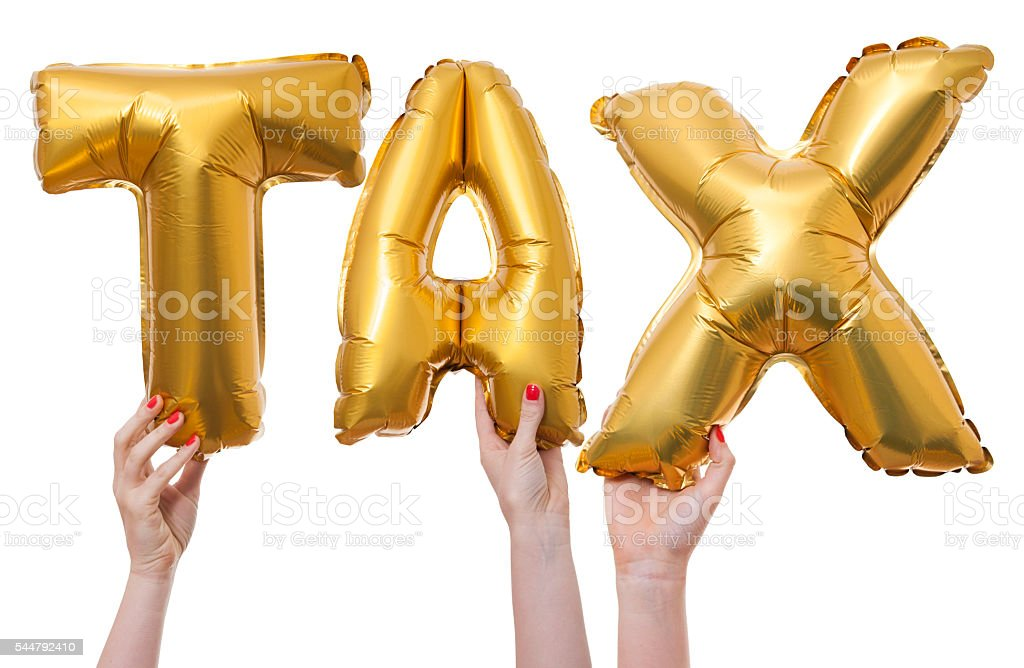 Tax word made from gold balloons stock photo