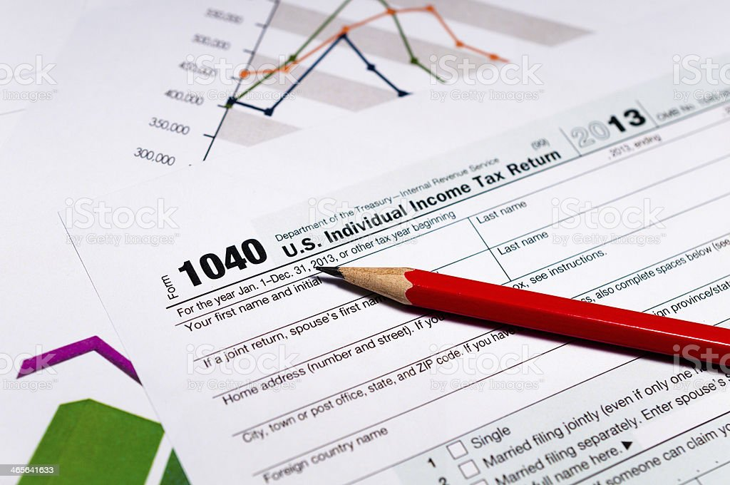 Taxation and finance concept, graphs, 1040, markets and financial figures royalty-free stock photo