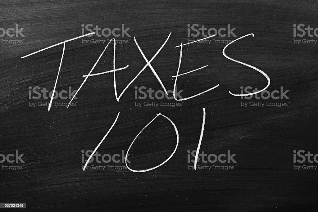Taxes 101 On A Blackboard stock photo
