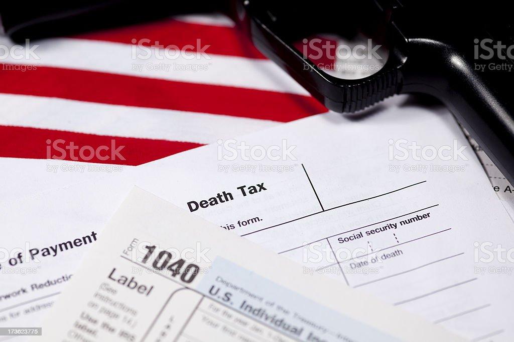 Taxes and a Gun stock photo