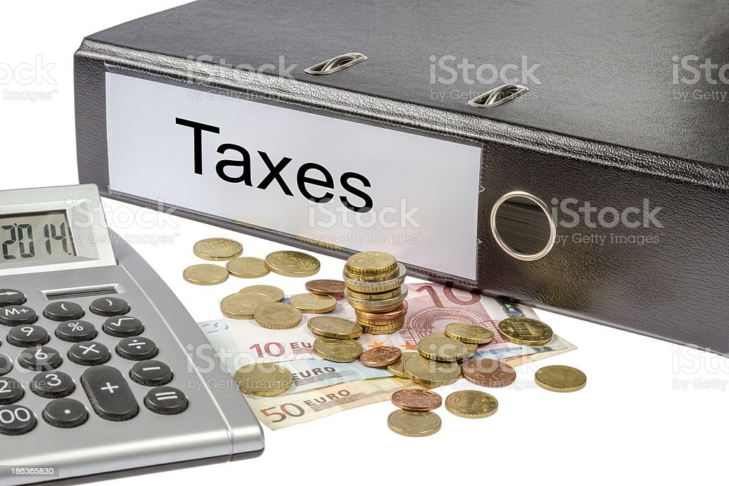 Taxes Binder Calculator and Currency stock photo