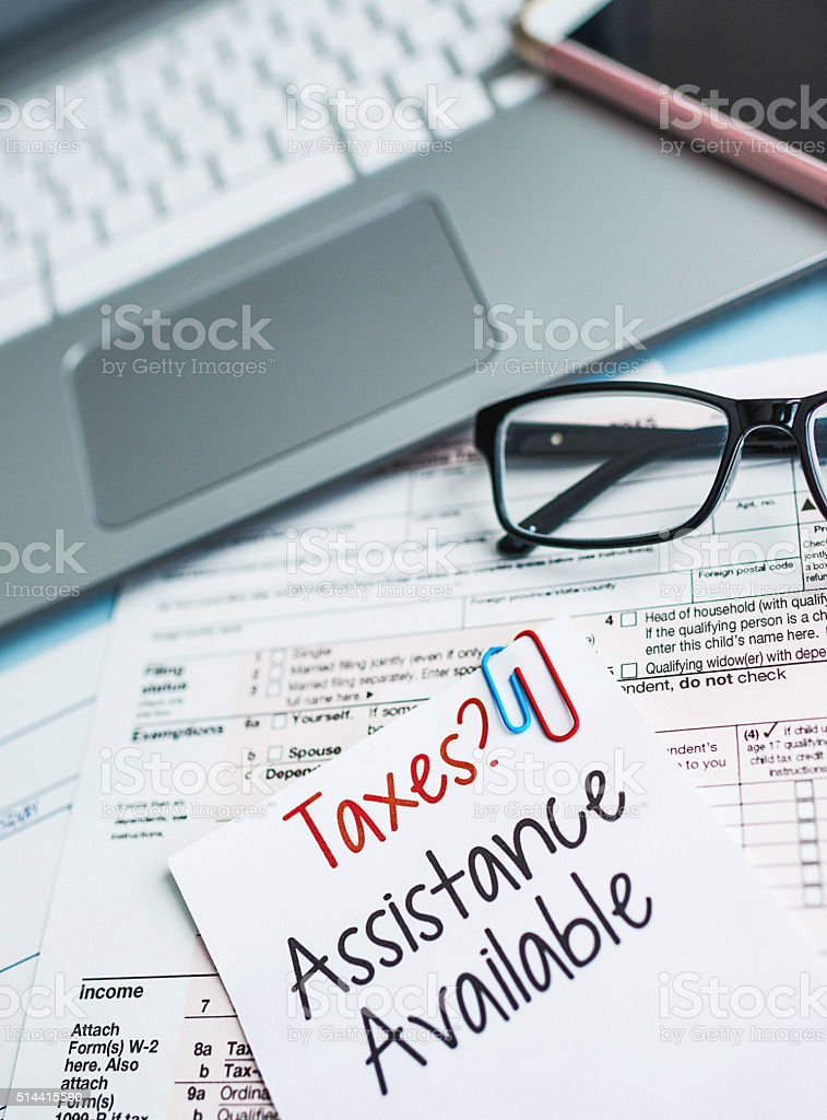Taxes preparation with note offering assistance stock photo