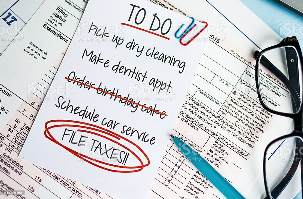 Taxes preparation with To Do list highlighting File Taxes stock photo
