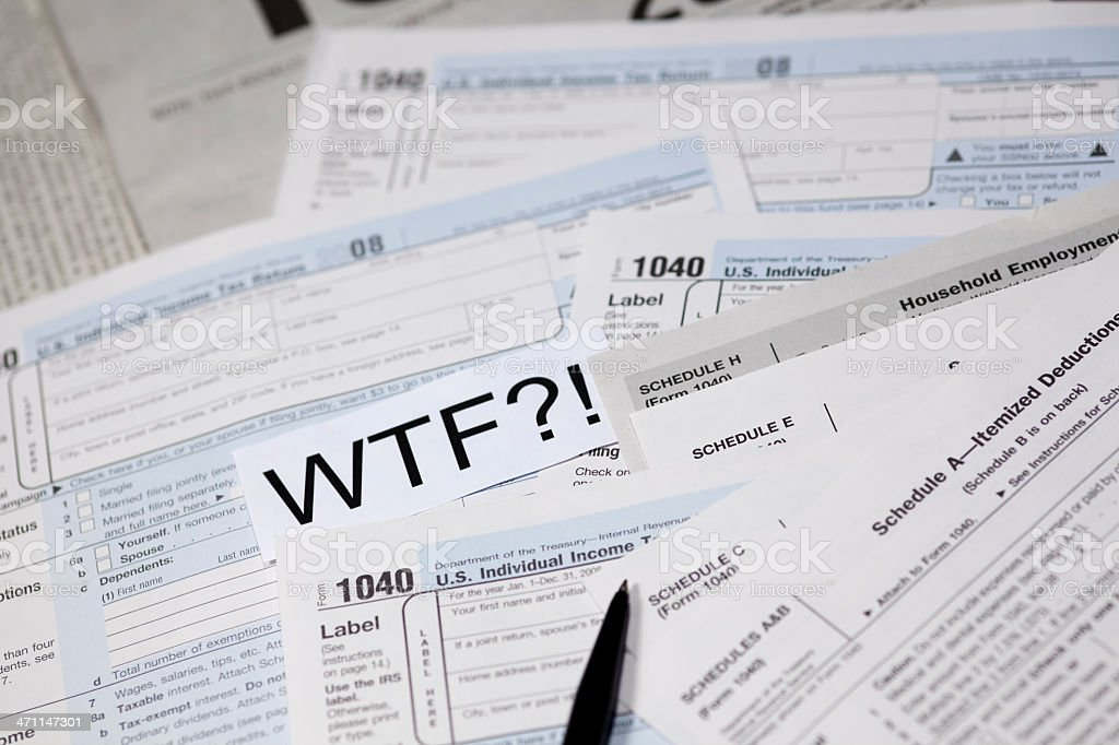 Taxes tax form US 1040 with WTF Expression stock photo
