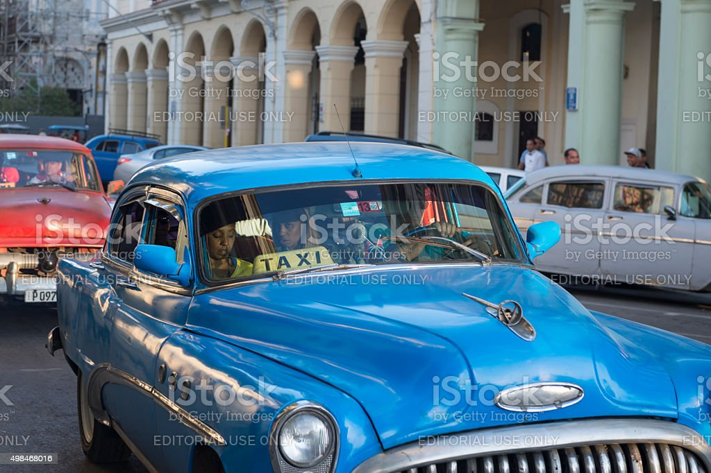 Taxi and passengers in Havana, Cuba stock photo