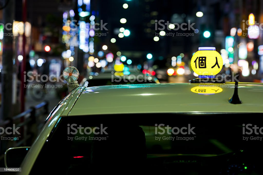 Taxi at night in Tokyo stock photo
