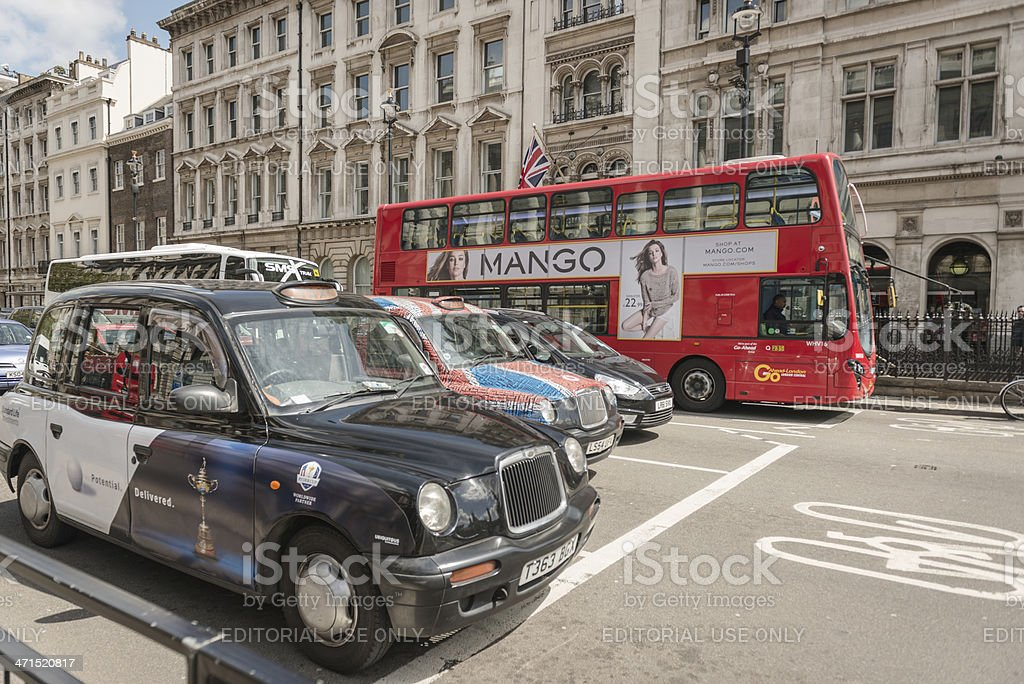 Taxi cab and double decker bus in the london street royalty-free stock photo