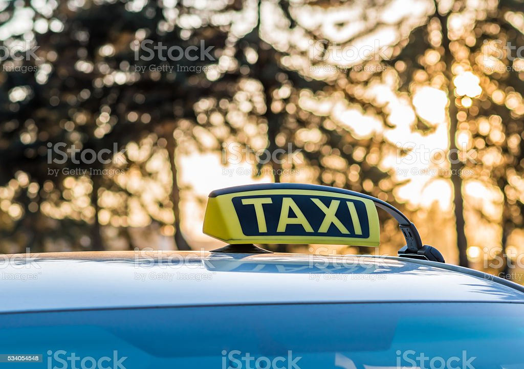 Taxi cab at sunset near the park stock photo