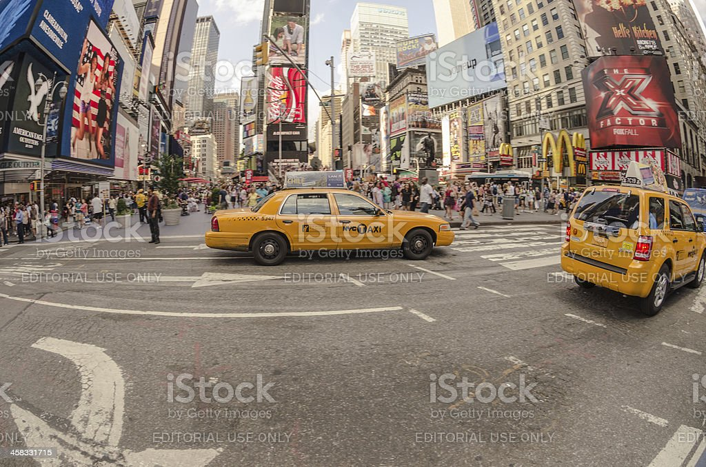 Taxi cab on the traffic of Times Square royalty-free stock photo