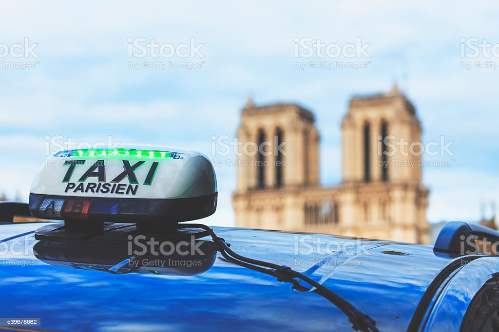Taxi cab parked by Notre Dame in Paris France stock photo