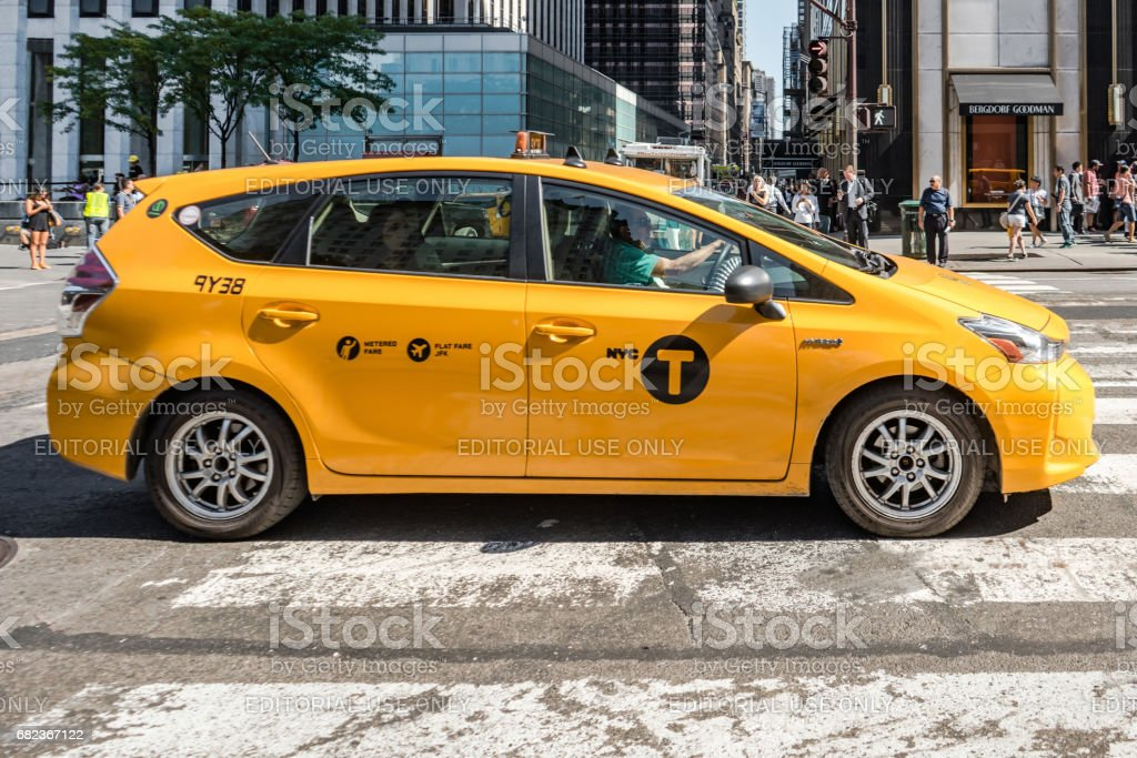 Taxi cab side on cross walk, Fifth Avenue, New York City. stock photo