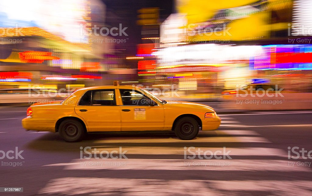 Taxi cab speeding through New York City, with motion blur stock photo