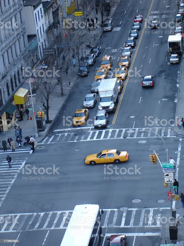 Taxi Crossing Busy NYC Intersection stock photo