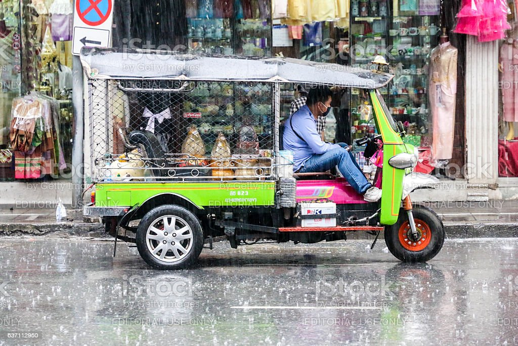 Taxi driver sitting in Tuk Tuk stock photo