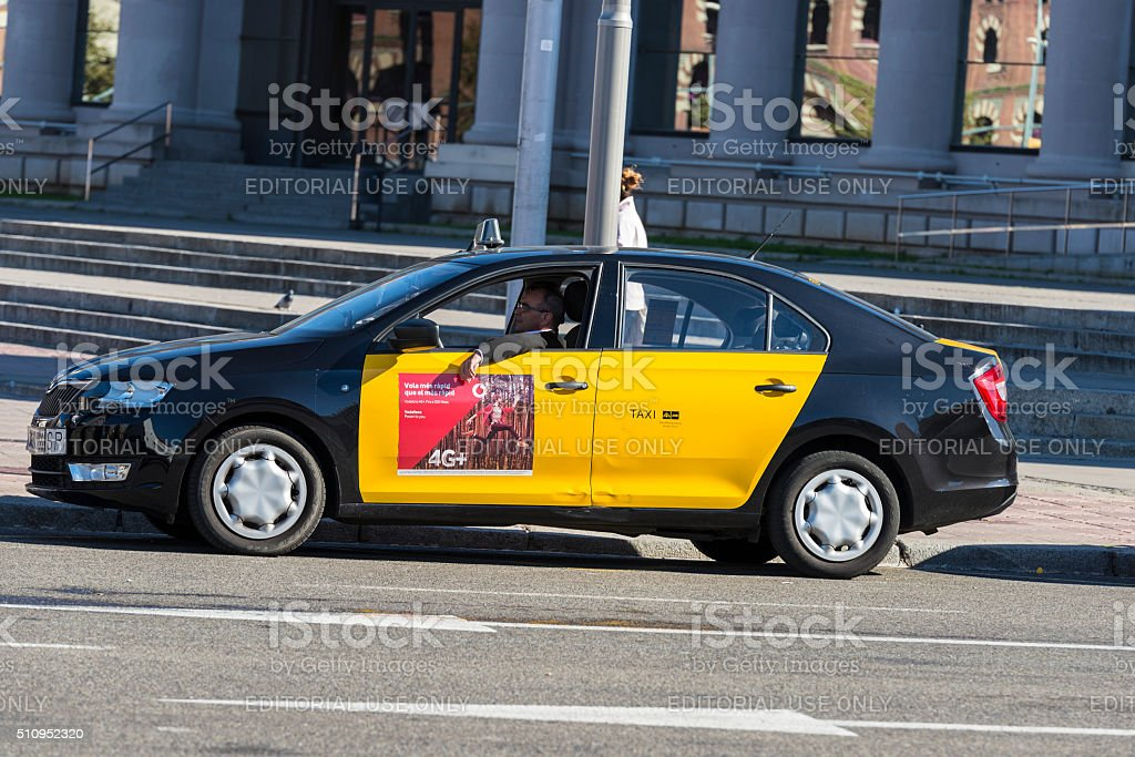 Taxi driver waiting for passengers, Barcelona stock photo