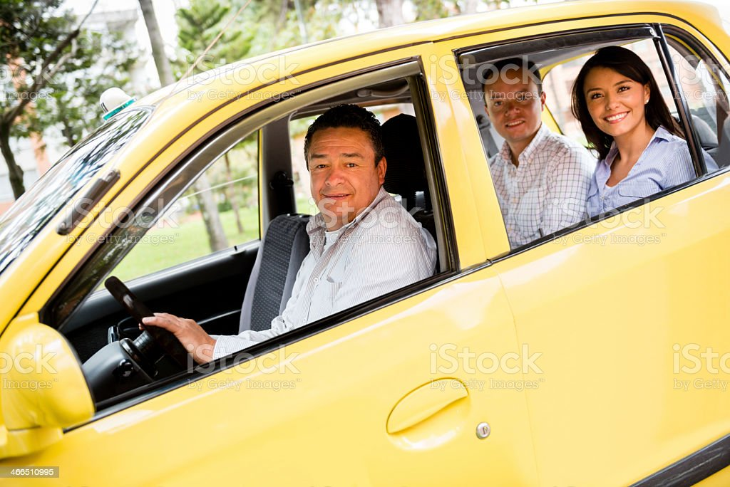 Taxi driver with passengers stock photo