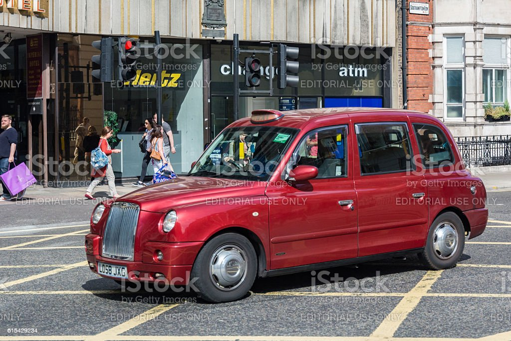 Taxi driving in a street of London stock photo
