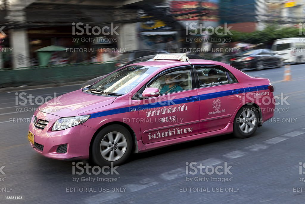 Taxi in Bangkok with passengers royalty-free stock photo