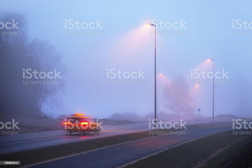 Taxi in fog stock photo