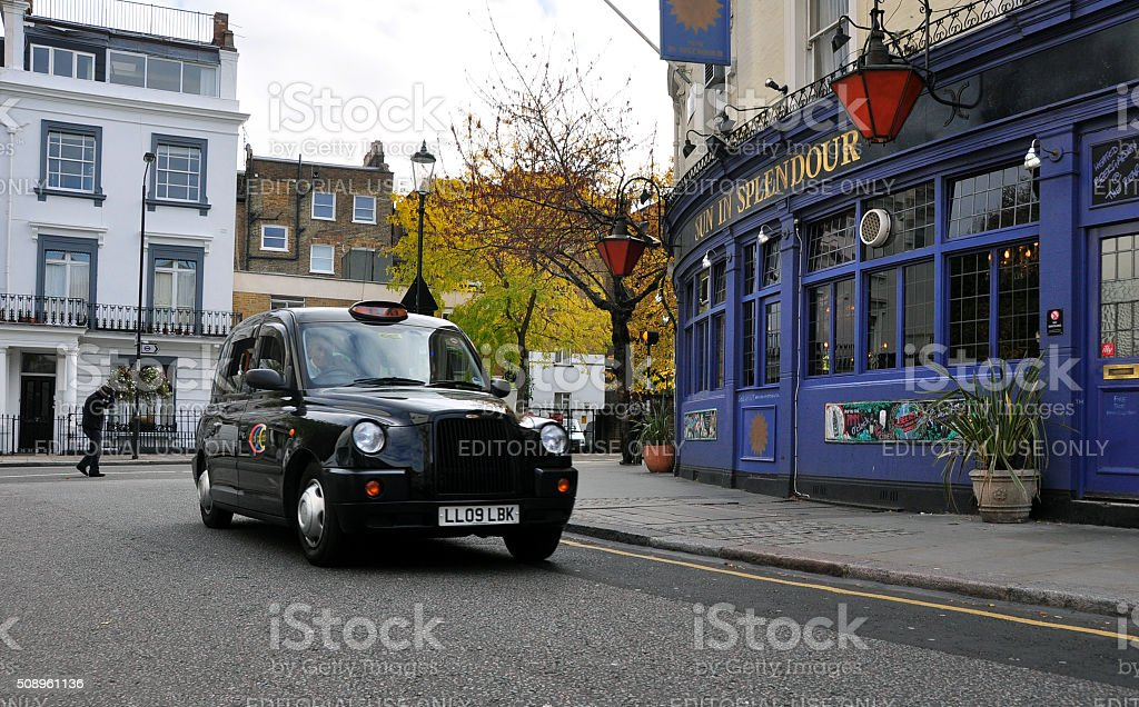 Taxi in Notting Hill, London stock photo