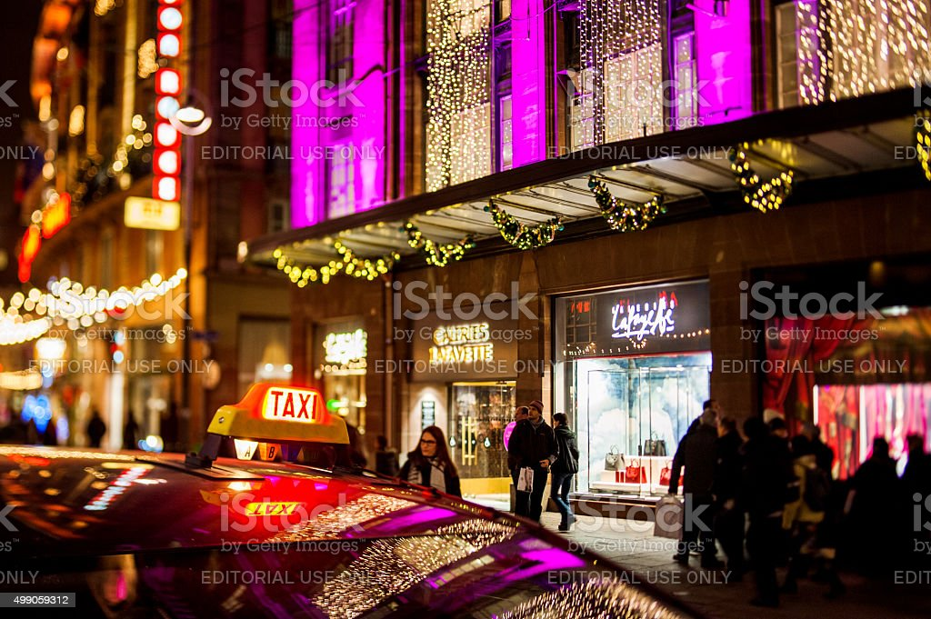 Taxi in the center near Galeries Lafayette luxury shopping mall stock photo