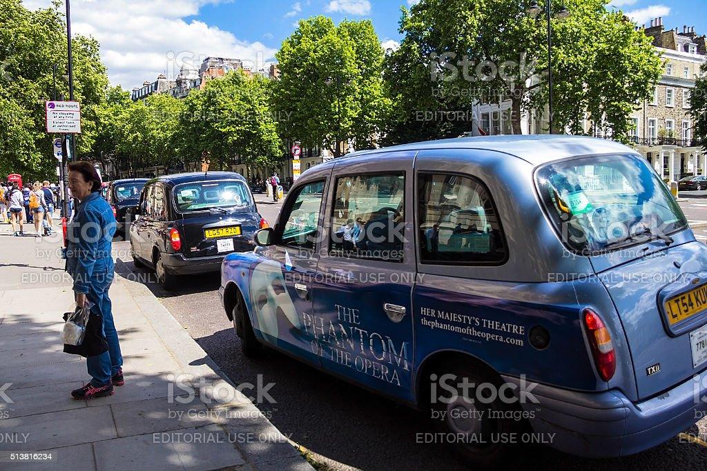 Taxi on Cromwell Gardens street, South Kensington, London, United Kingdom stock photo
