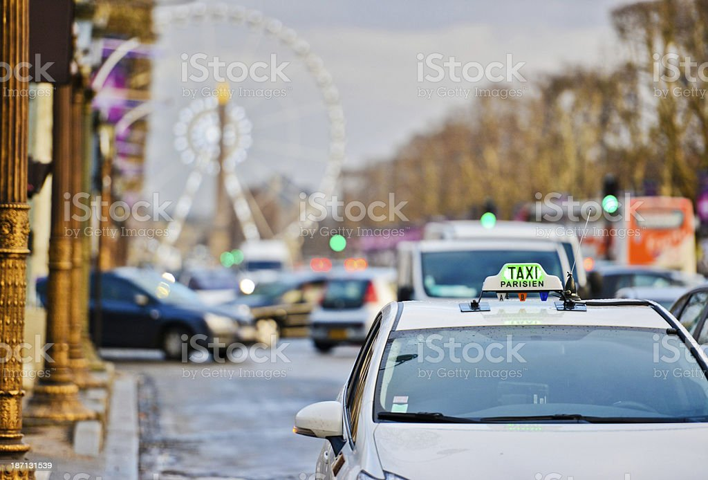 Taxi Parisien on Champs-Elysees stock photo