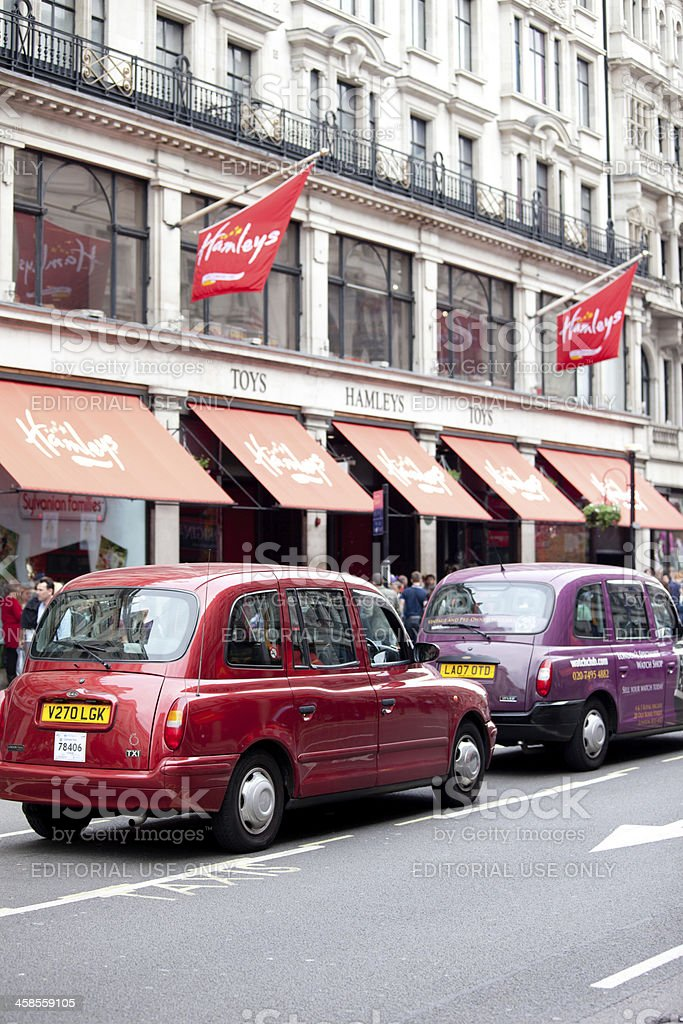 Taxi perked in front of Hamleys toys shop royalty-free stock photo
